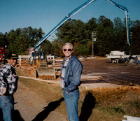 Image of General Contractor Terry Fox and a member of his Atlanta team on a construction site in 1995.  Fox Building has been a general contractor in the southeastern U.S. since 1985.